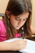 Hispanic girl working on her homework