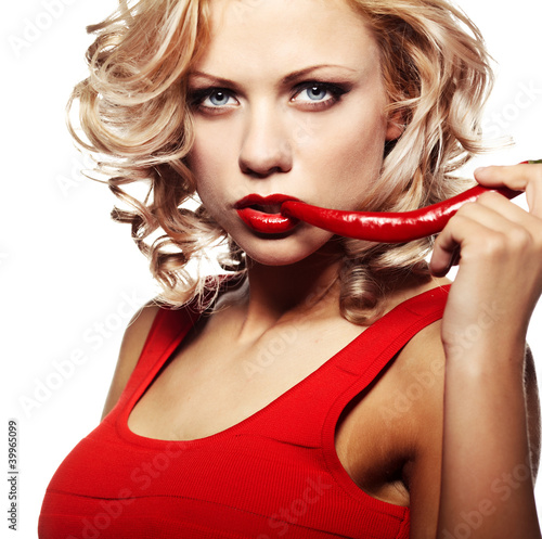 Sexy woman wearing red dress with chili pepper isolated on white
