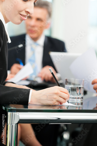 Business meeting with work on contract
