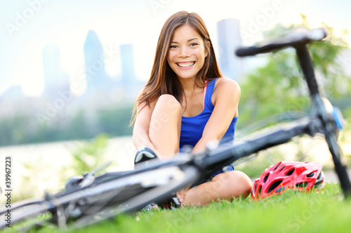 Woman going biking on road bike