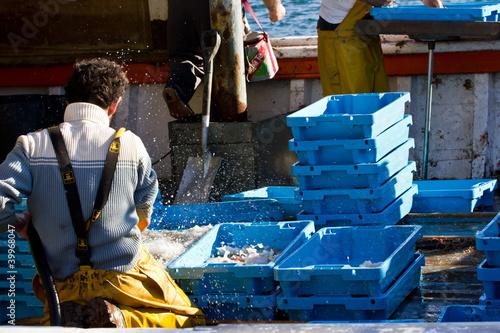 Leinwanddruck Bild Arrivée de pêche