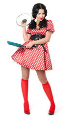 Young sexy girl in a polka dot with frying pan on white