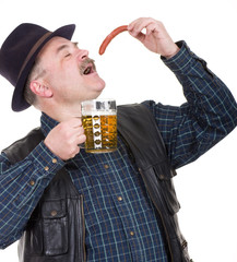 Elderly man holding a beer belly and sausage