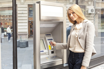 Woman using Bank ATM machine