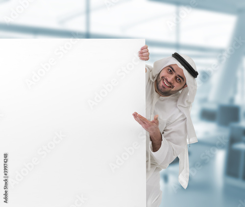 arabian businessman pointing at a blank sign with clipping path