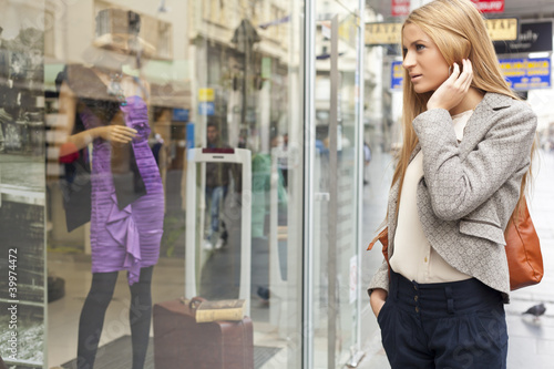 Woman looking at window in shoping street