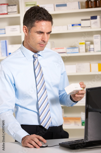 UK pharmacist working on computer