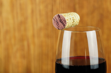 Glass and cork of fine Italian red wine, closeup