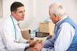 American doctor talking to senior man in surgery