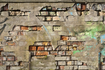 old wall with cracks and graffiti