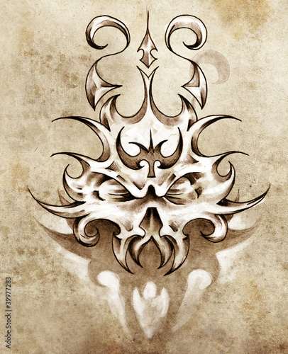 Sketch of tattoo art, skull mask with tribal design