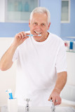 Senior man brushing teeth