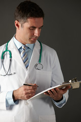 American doctor with clipboard and stethoscope