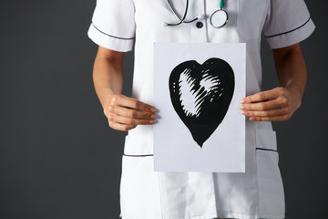 American nurse holding ink drawing of heart