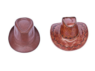 Two brown leather hat isolated on white