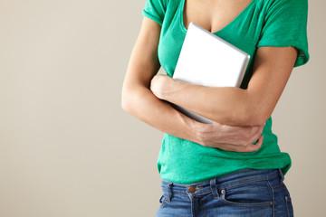 Woman holding tablet studio shot