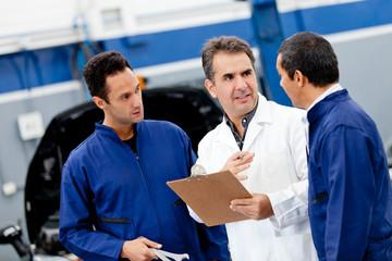 Car mechanics talking