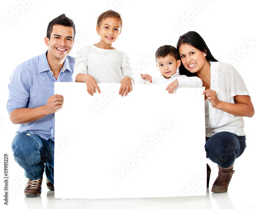 Family holding a banner