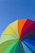 Colorful umbrella on a sky background, vertical view
