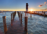 Fototapety Lighthouse at Lake Neusiedl at sunset