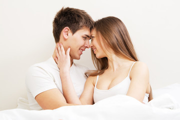 Beautiful young couple in bed