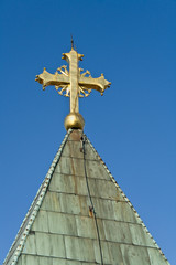 Golden cross on church
