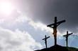 three crosses beneath stormclouds