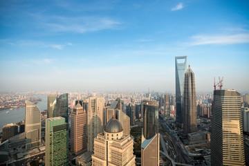 shanghai against a blue sky at dusk