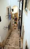 Narrow street in Alfama neighborhood, Lisbon city, Portugal