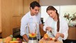 Couple putting fruits into a blender