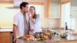 Woman feeding her husband a tomato