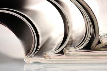 open magazines isolated on white