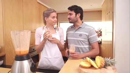 Couple drinking smoothies