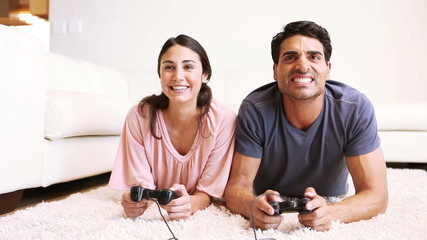 A young couple playing video games