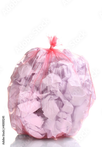 red garbage bag with trash isolated on white