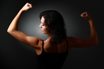 Strong woman. Back
