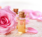 Fototapety Bottles of Essential Oil for Aromatherapy. Rose Spa