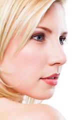 attraktive junge blonde Frau, über die Schulter schauend