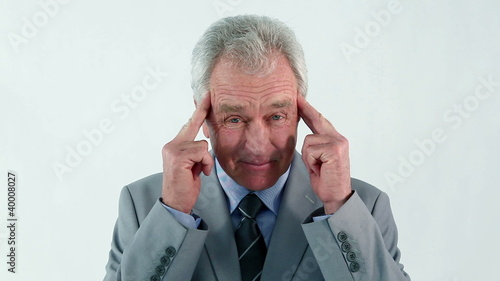 Serious businessman showing his headache