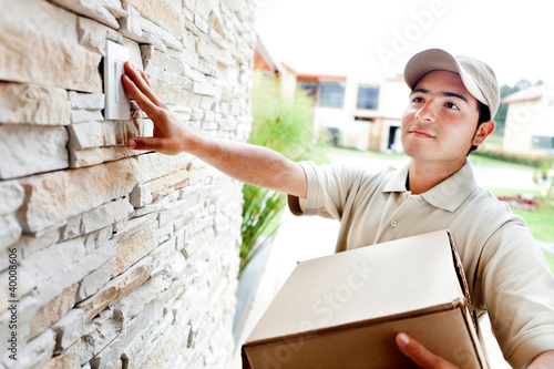Delivery man ringing doorbell