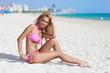 Model in a bikini smiling on the beach
