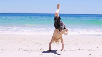 Blonde kid doing a handstand