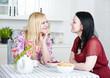 Two women talking in the kitchen