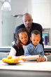 Young black family in fresh modern kitchen