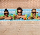 Happy companionship in swimming pool poster