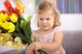 Little girl with tulips