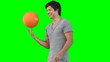 A man spinning a basketball on his hand