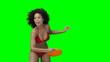 A woman in her swimwear throwing a Frisbee