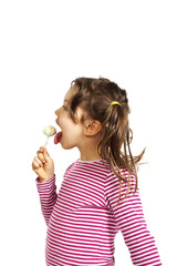 portrait of little girl with a lollipop