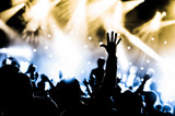 Fototapety crowd with hands raised at a live music concert